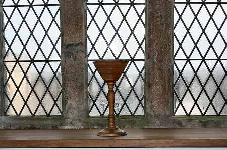 A wood turned chalice in the perpendicular window