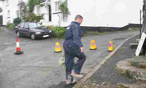 Builder carrying tool into Church House