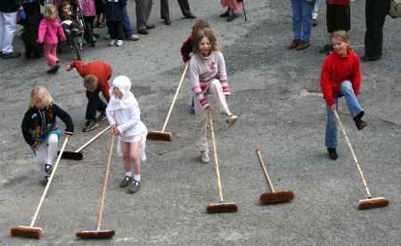Broom dancing - one walks away!
